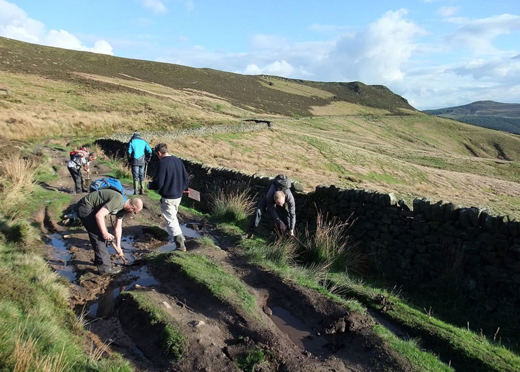 Trail Maintenance by Peak District MTB on Derwent Edge over looking Ladybower